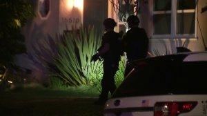 Police search an Encino neighborhood following a burglary on Feb. 17, 2020. (Credit: KTLA)