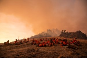 Inmate firefighters take a break during the Kincade Fire in Healdsburg, California, on Oct. 26, 2019. (Credit: Philip Pacheco/AFP via Getty Images)