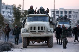 A picture taken during a guided tour organized by the Syrian army shows regime forces in the area of al-Lirmoun, north of Aleppo, on Feb. 17, 2020. (Credit: Louai Beshara / AFP / Getty Images)