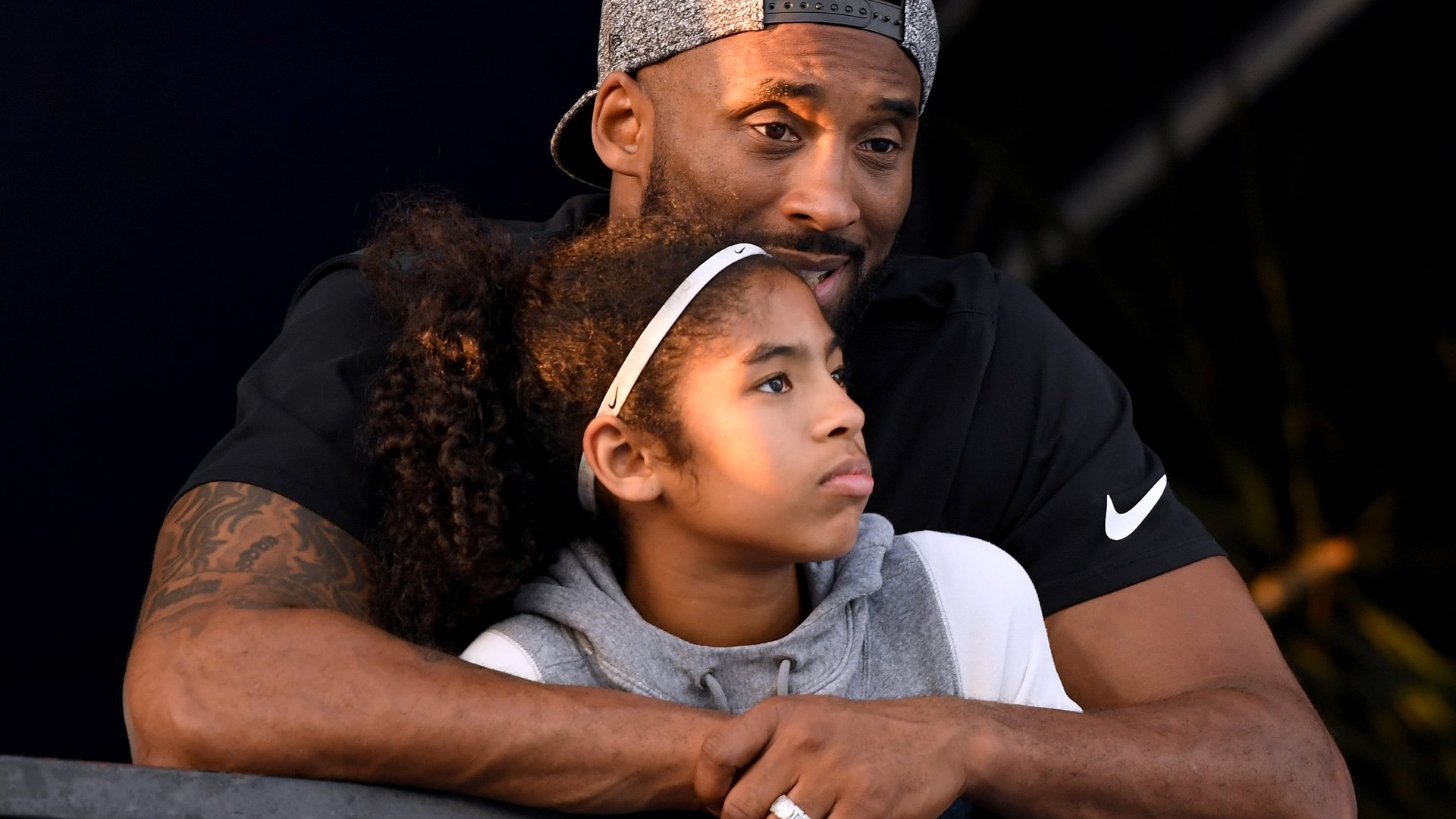 Kobe Bryant and daughter Gianna Bryant watch the Phillips 66 National Swimming Championships at the Woollett Aquatics Center on July 26, 2018 in Irvine. (Credit: Harry How/Getty Images)