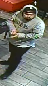 A man who allegedly attacked a Santa Ana restaurant manager on Super Bowl Sunday is shown in surveillance video released by police on Feb. 13, 2020.