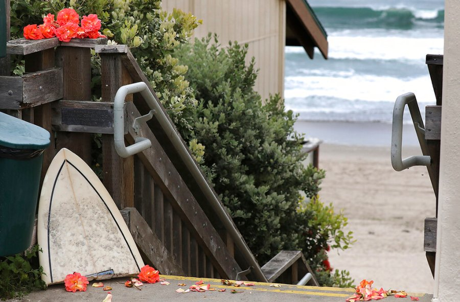 The broken nose of a surfboard along with fresh flower blossoms form a makeshift memorial to surfer Ben Kelly Sunday morning, May 10, 2020 at the top of the stairs to San Dollar Beach.(Shmuel Thaler/The Santa Cruz Sentinel via AP)